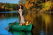 woman on a boat in the autumn