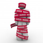 An unhappy man is wrapped in red tape with the word Married to illustrate being trapped or caught in