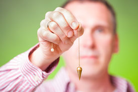 picture of pendulum  - Hand with pendulum - JPG