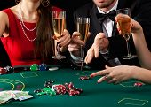 image of gambler  - A couple of gamblers drinking a glass of champagne - JPG