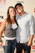 Melissa Claire Egan and Theo Rossi  at the Premiere Screening of 'Sons of Anarchy'. Paramount Theate