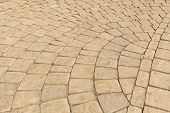 stock photo of paving  - Pavement paved with light brown cobblestone in Yerevan - JPG