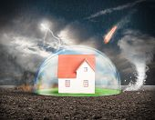 foto of meteoric rain  - Concept of home protection insurance with crystal sphere - JPG