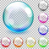 stock photo of adornment  - Set of multicolored transparent glass spheres on a plaid background - JPG