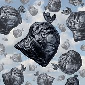 picture of waste management  - Garbage concept as black trash bags with an unpleasant smell falling from the sky as a background of environmental damage issues and waste management problems - JPG