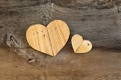 foto of elm  - Two Love Valentines wooden hearts from recycled old palette on old grey Elm background copy space - JPG