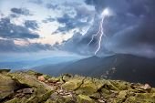 stock photo of rain cloud  - thunderstorm with lightening and dramatic clouds in Carpathian mountains - JPG