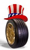 foto of uncle  - American transportation with car tire wearing Uncle Sam hat - JPG