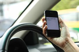 image of unsafe  - Texting and driving is dangerous and no unsafe.