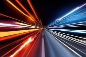 picture of traffic light  - Fast moving traffic light trails at night - JPG