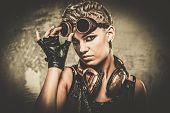 stock photo of steampunk  - Attractive steampunk girl wearing googles - JPG