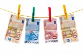 stock photo of clotheslines  - Euro banknotes on clothesline isolated on white background with clipping path - JPG