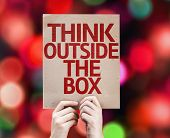 stock photo of thinking outside box  - Think Outside the Box card with colorful background with defocused lights - JPG