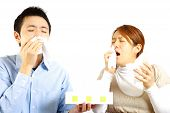 stock photo of rhinitis  - portrait of Japanese Couple suffers from allergic rhinitis - JPG