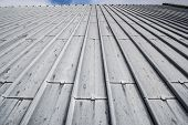 foto of roofs  - Heavy duty sheet metal roof with the horizon line visible at the top - JPG