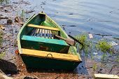 image of old boat  - old fishing boat anchored on the shore of the lake - JPG