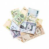 stock photo of saudi arabia  - Pile of modern Saudi Arabia money banknotes isolated on white background close - JPG