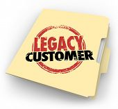 stock photo of clientele  - Legacy Customer words stamped on a manila file folder for a client or buyer who is faithful - JPG