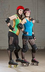 foto of roller-derby  - Pair of roller derby skater friends with helmets - JPG