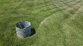 stock photo of mouse trap  - Passive simple rodent trap installed in cultivated grass field - JPG