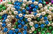 image of carnivale  - A lot of mardi Gras Beads closeup - JPG