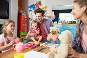 picture of indoor games  - Parents Playing Game With Children And Toys In Bedroom - JPG