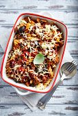 stock photo of aubergines  - Fusilli pasta baked with cherry tomatoes, aubergine and cheese  - JPG