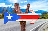 stock photo of greater antilles  - Puerto Rico Flag wooden sign with road background - JPG