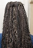 stock photo of braids  - model with black and light beige colors kanekalon material African braids on the hair - JPG