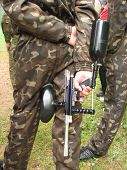 image of gun shot wound  - weapon in the hands of paintball player - JPG
