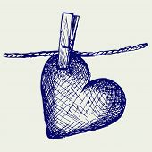 picture of clotheslines  - Heart in clothesline - JPG