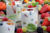 stock photo of yogurt  - Three glasses with plain yogurt and mixed fresh fruit - JPG