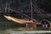 picture of raft  - Floating squid fishing net on a large raft in Halong bay - JPG