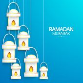 pic of dua  - Shiny illuminated lanterns or lamps on sky blue background for holy month of Muslim community Ramadan Kareem celebration - JPG