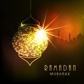 pic of ramadan mubarak  - Shiny golden hanging Arabic lamp with wishing text Ramadan Mubarak on Islamic Mosque silhouette background for Muslim community festival celebration - JPG