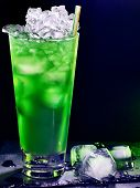 stock photo of mint-green  - Green drink  with cube ice and mint leaf on dark background  - JPG