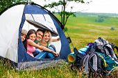 foto of tent  - Group people with backpack in tent  hide from rain summer outdoor - JPG