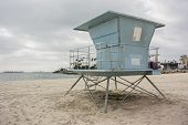 picture of lifeguard  - A light blue lifeguard sand on a sandy beach in California - JPG