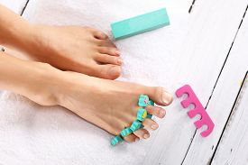 stock photo of wet feet  - Foot care treatment and nail - JPG