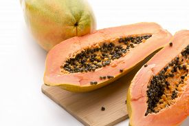 pic of papaya fruit  - Papaya halved with a longitudinal cut - JPG