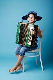 picture of accordion  - little funny accordion player on blue background - JPG