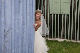 foto of cheeky  - a Cheeky bride playing with the camera - JPG