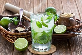 picture of mint-green  - Mojito cocktail delicious summer drink with lime mint and ice on rustic wooden table - JPG