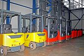 picture of lift truck  - Yellow and red fork lifters in warehouse - JPG