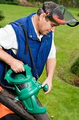 stock photo of leaf-blower  - Man with leaf blower - JPG