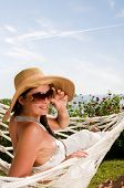 pic of woman beach  - Young woman in hammock - JPG