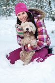 stock photo of westie  - Happy woman with dog in winter forest - JPG