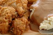 stock photo of fried chicken  - Fried chicken with mashed potatoes and gravy - JPG
