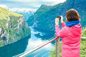 Tourist Taking Photo From Flydasjuvet Viewpoint Norway poster