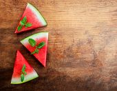 Watermelon Slice With Mint On Rustic Wood Background. Copyspace.. Flat Lay. Summertime Concept. poster